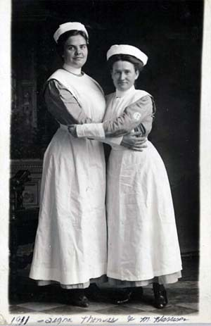 Two young female nurses from the early 20th century, which is the icon for insitutional history collections in IDA